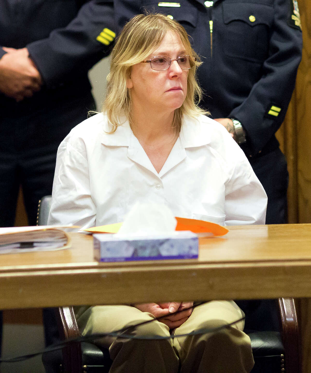 Joyce Mitchell, a former prison employee who provided the tools that two murderers used to cut their way out of a maximum-security facility in northern New York, listens intently to Judge Kevin Ryan during a restitution hearing at the Clinton County Government Center, Friday, Nov. 6, 2015, in Plattsburgh, N.Y. Mitchell's will pay $79,841, plus a 10 percent surcharge, for the damage Richard Matt and David Sweat caused by using hacksaw blades and other tools she provided to break out of Clinton Correctional Facility in June, a prosecutor said. (Gabe Dickens/Press-Republican via AP)