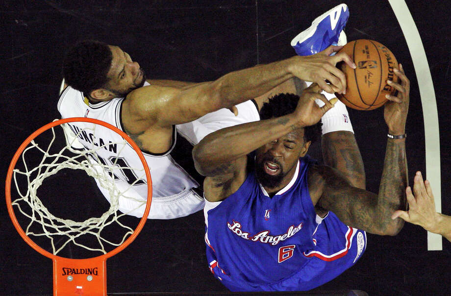 San Antonio Spurs' Tim Duncan defends Los Angeles Clippers' DeAndre Jordan during Game 4 in the Western Conference playoffs Sunday April 26, 2015 at the AT&T Center.  The Clippers won 114-105. Photo: Edward A. Ornelas, Staff / San Antonio Express-News / © 2015 San Antonio Express-News
