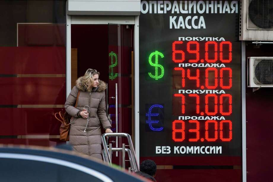 An exchange office sign in Moscow shows currency rates this week for the Russian ruble, the U.S. dollar and the euro. Photo: Alexander Zemlianichenko, STF / AP