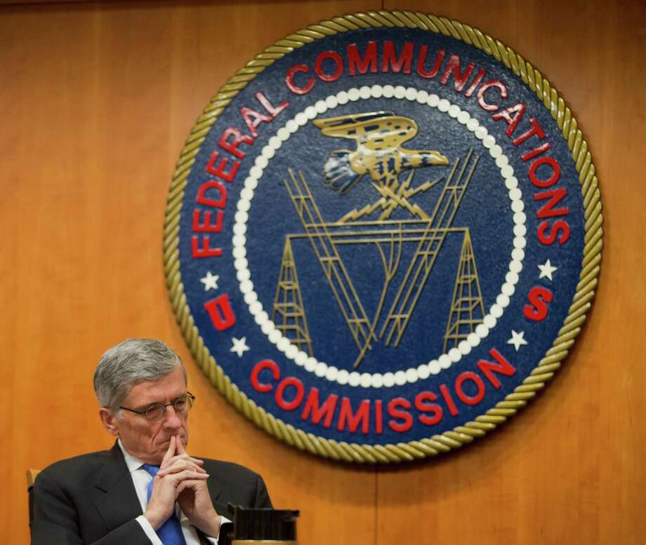 "FILE - In this Thursday, Feb. 26, 2015, file photo, Federal Communications Commission (FCC) Chairman Tom Wheeler listens to commissioners speak prior to a vote on Net Neutrality, at the FCC in Washington. The FCC issuing ""net neutrality'' rules designed to bar Internet service providers from offering preferential treatment to sites that pay for faster service, was one of The Associated Press' top stories in 2015. (AP Photo/Pablo Martinez Monsivais, File) Photo: Pablo Martinez Monsivais, STF / AP"