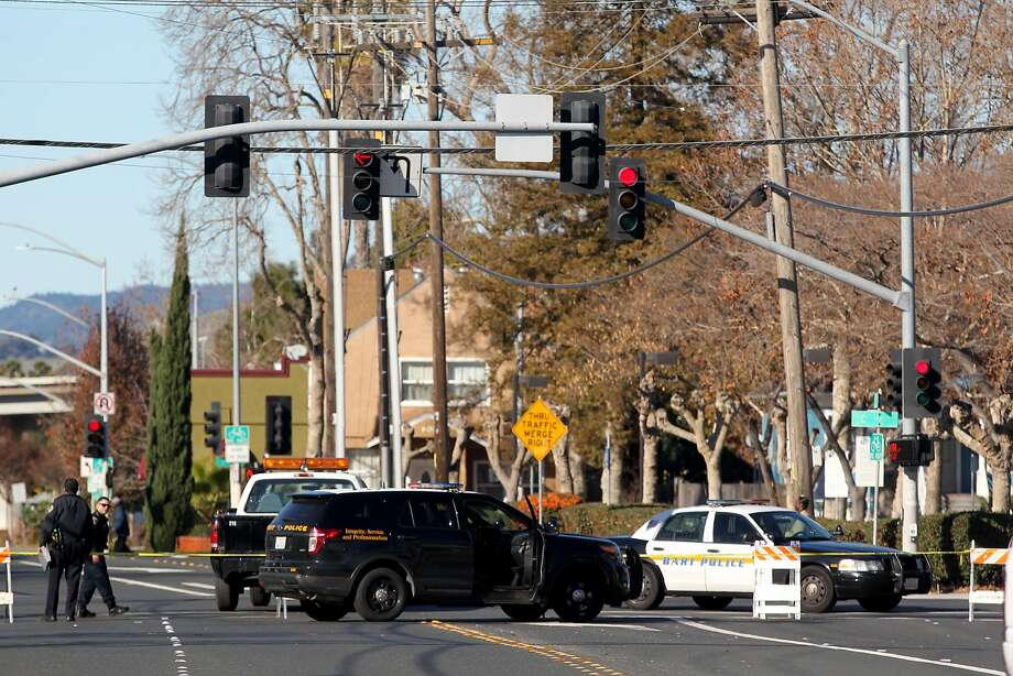 Police block off access to Grand Street from C Street while investigating the scene of an officer involved shooting behind the Hayward BART station in Hayward, Calif., Friday, Dec. 25, 2015. Photo: Anda Chu, Associated Press