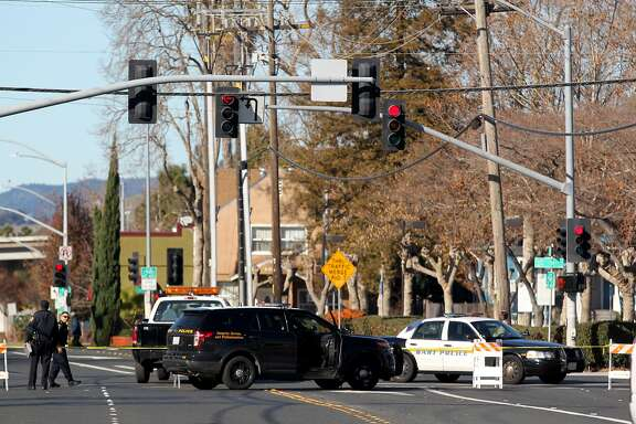 Police block off access to Grand Street from C Street while investigating the scene of an officer involved shooting behind Hayward Bart in Hayward, Calif., Friday, Dec. 25, 2015. (Anda Chu/Bay Area News Group) MANDATORY CREDIT