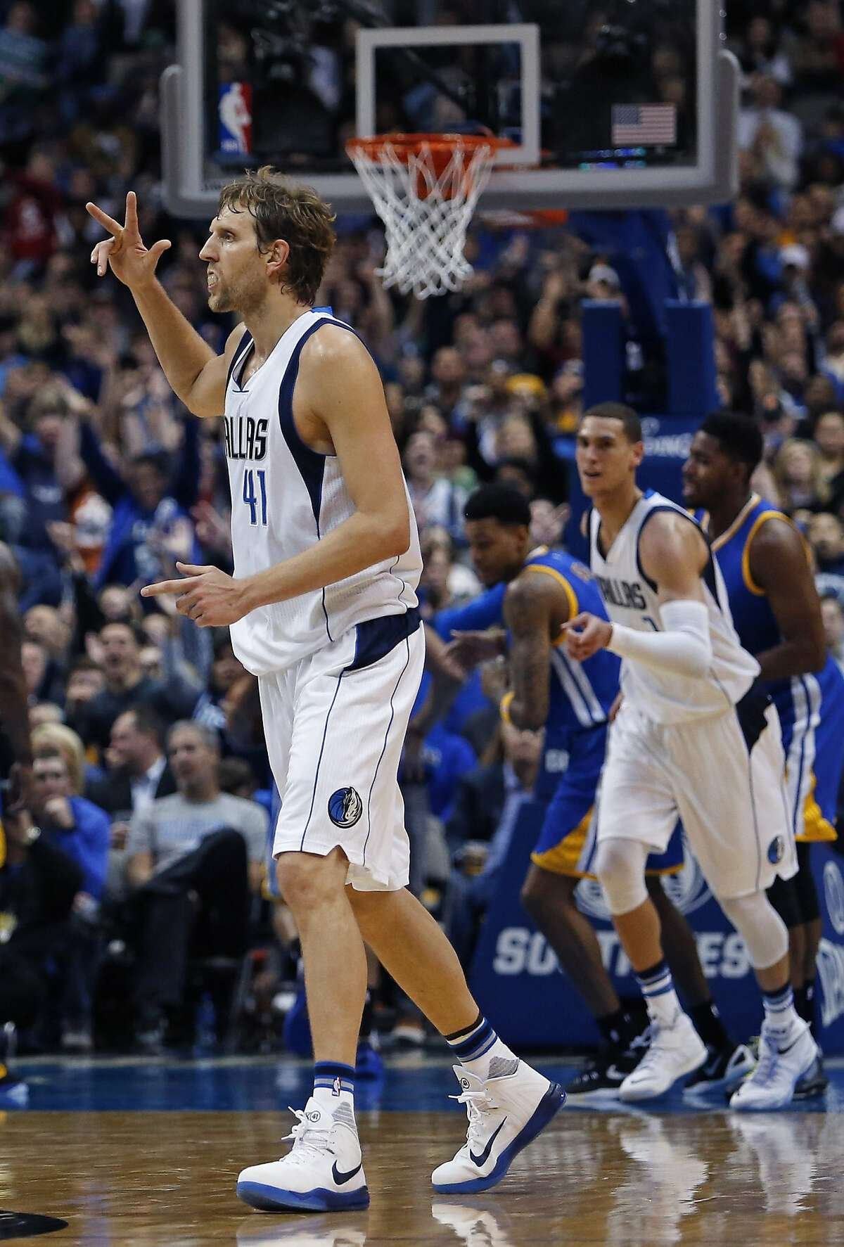 The Dallas Mavericks' Dirk Nowitzki (41) reacts after sinking a three-point shot in the fourth quarter against the Golden State Warriors at the American Airlines Center in Dallas on Wednesday, Dec. 30, 2015. The Mavs won, 114-91.