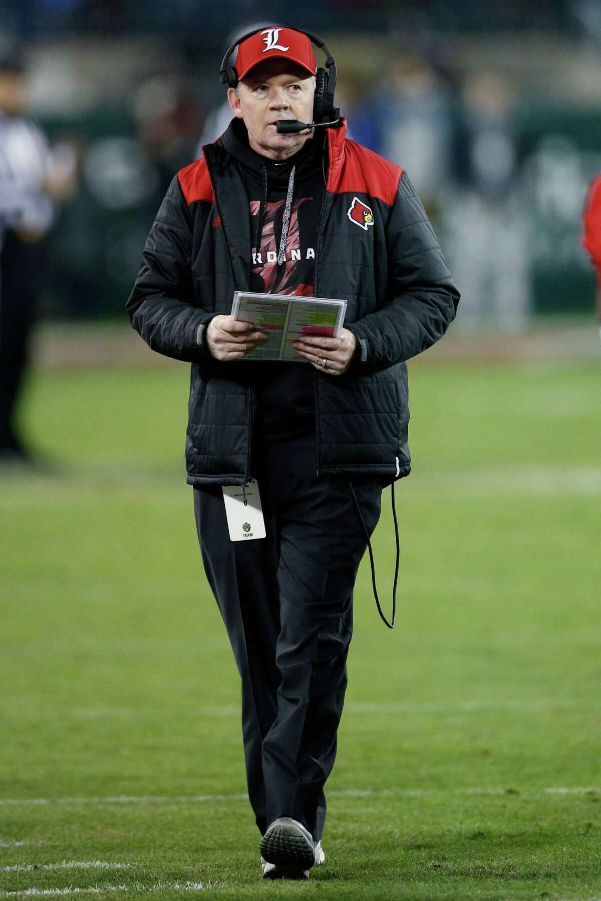 NASHVILLE, TN - DECEMBER 30: Head coach Bobby Petrino of the Louisville Cardinals looks on against the Texas A&M Aggies in the second half of the Franklin American Mortgage Music City Bowl at Nissan Stadium on December 30, 2015 in Nashville, Tennessee.
