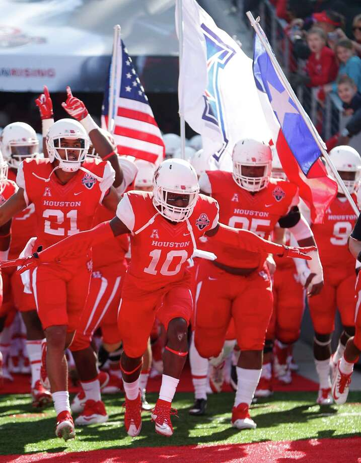 The Houston Cougars have charged onto the national scene by winning the American Athletic Conference title, and today they'll try to take down a high-profile Florida State program. Photo: Karen Warren, Staff / © 2015  Houston Chronicle