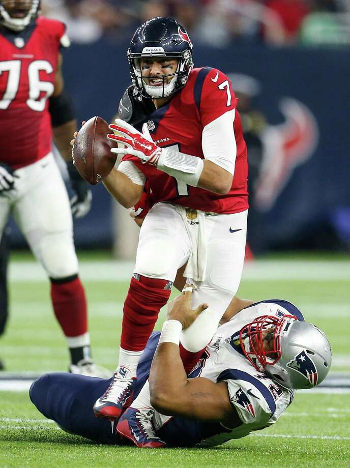 Brian Hoyer, who was injured on this sack by the Patriots' Akiem Hicks, finally is cleared to play. Photo: Karen Warren, Staff / © 2015  Houston Chronicle