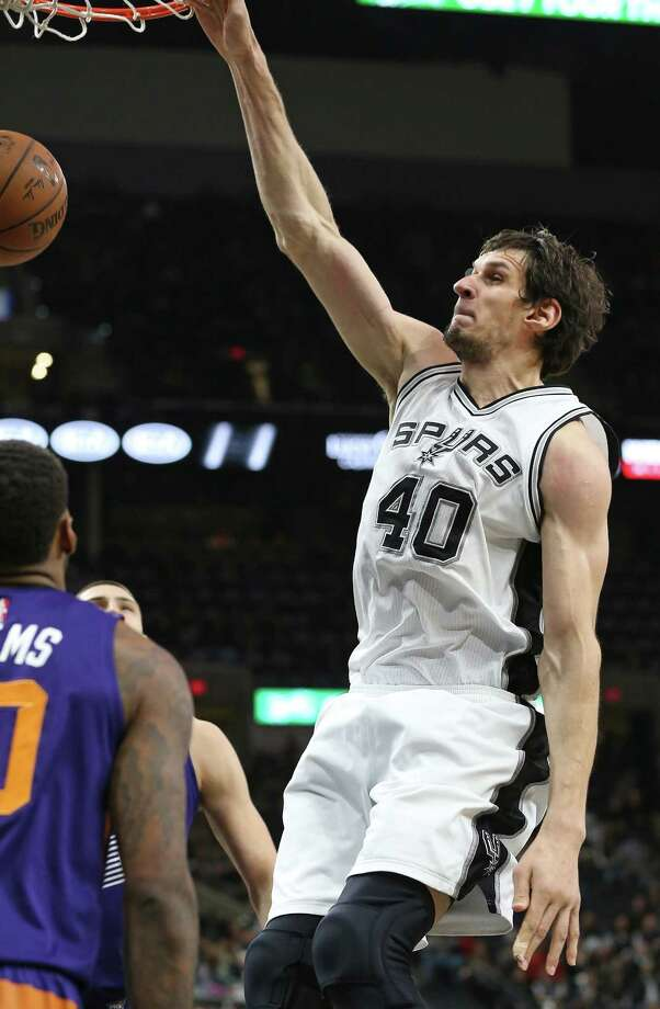 Boban Majanovic crashes through with a dunk in the second half as the Spurs host the Suns at the AT&T Center on December 30, 2015. Photo: TOM REEL, STAFF / SAN ANTONIO EXPRESS-NEWS / 2015 SAN ANTONIO EXPRESS-NEWS
