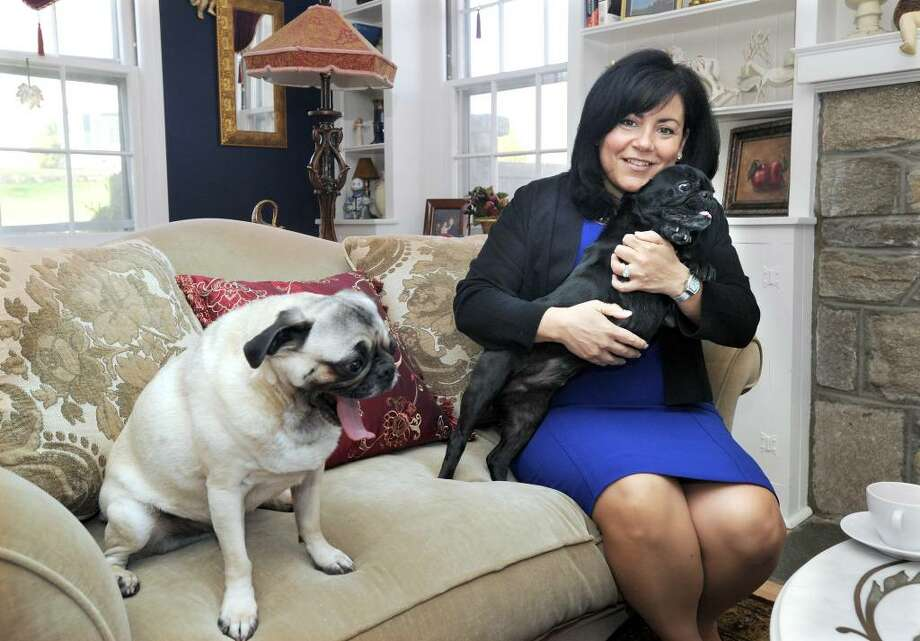 Phyllis Boughton, wife of Danbury Mayor Mark Boughton, pictured in the living room of her home with dogs Buddy, left, and Spike, Thursday, April 1, 2010. Photo: Carol Kaliff / The News-Times