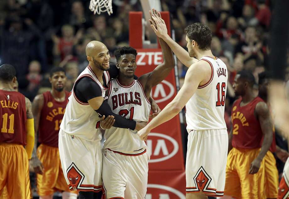 Jimmy Butler (center) and Pau Gasol (right) teamed for the winning shot, to the delight of Taj Gibson. Photo: Nam Y. Huh, Associated Press