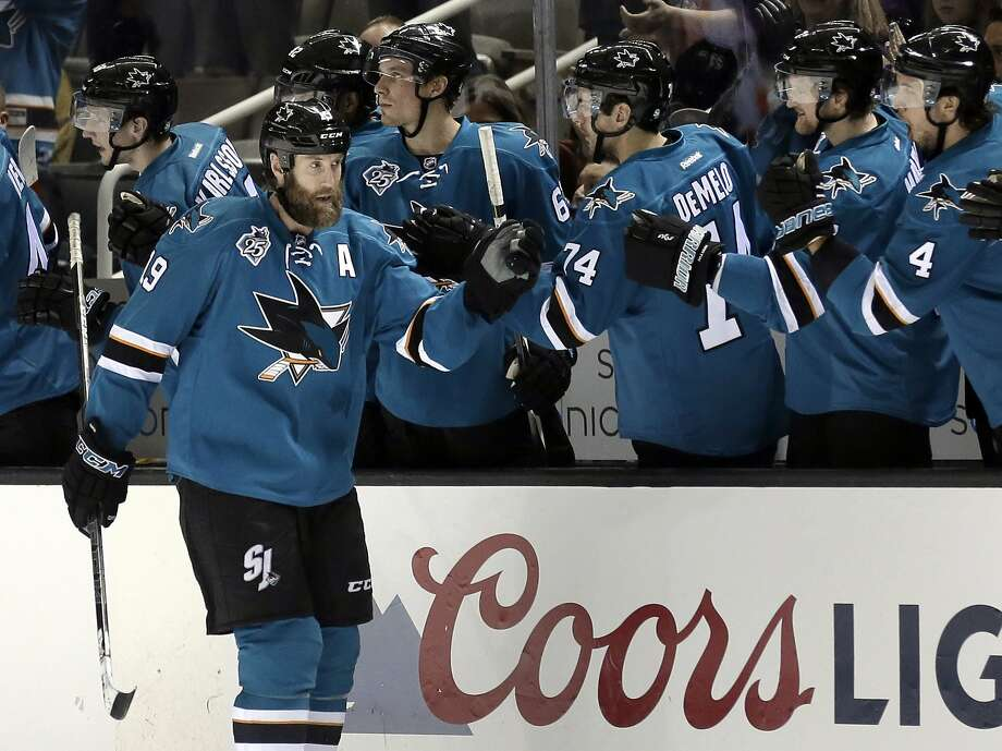 San Jose Sharks' Joe Thornton, left, is congratulated after scoring against the Philadelphia Flyers during the second period of an NHL hockey game Wednesday, Dec. 30, 2015, in San Jose, Calif. (AP Photo/Ben Margot) Photo: Ben Margot, Associated Press