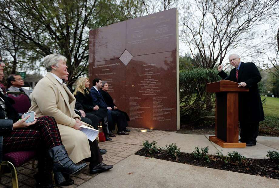 Charles Foster right, speaks as Mayor Annise Parker left, looks on during the gifting of two bronze relief panels depicting former U.S. Commerce Secretary Robert Mosbacher, Sr. the commemorative panels are located near the Preston Street Bridge in Sesquicentennial Park Wednesday, Dec. 30, 2015, in Houston. The bridge has been renamed as the Robert A. Mosbacher, Sr., Memorial Bridge. Photo: James Nielsen, Houston Chronicle / © 2015  Houston Chronicle