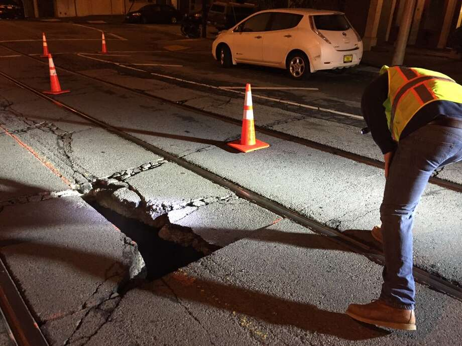 A sinkhole that opened up early Thursday near 24th and Church streets in San Francisco stopped the J-Church Muni line in both directions. Photo: Kale Williams / /