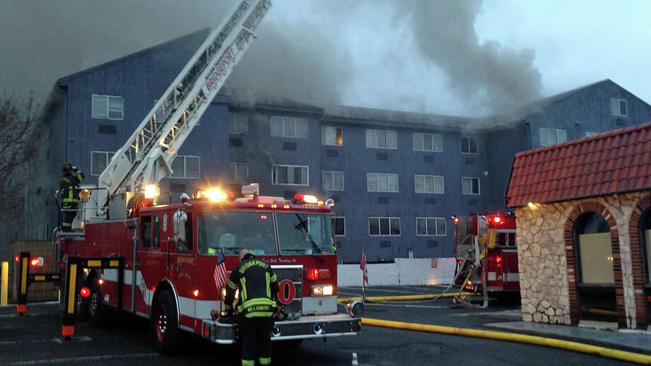 A two-alarm fire heavily damaged a condominium complex on 215 Charles St. in Bridgeport on Thursday, Dec. 31, 2015. It started with a car fire beneath the complex and quickly spread. There was also significant water and smoke damage. Photo: Jim Shay /Hearst Connecticut Media
