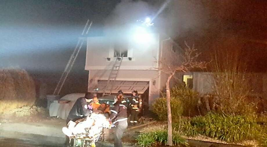 A 66-year-old man was rescued from his burning home after an early morning house fire in Santa Rosa Thursday, Dec. 31, 2015. Photo: Courtesy, Santa Rosa Fire Department