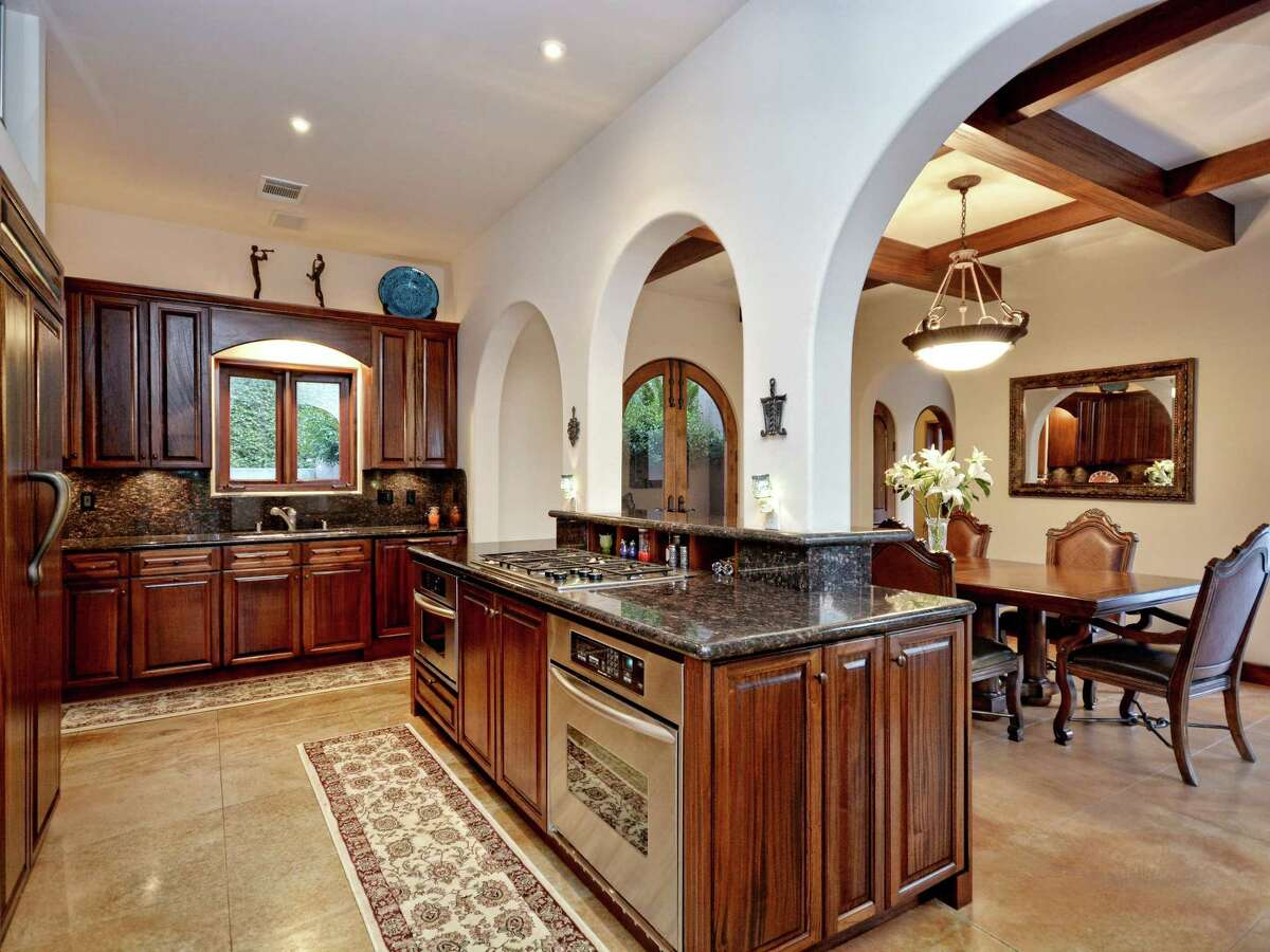 Located at 1516 Wild Cat Hollow in Austin's West Lake Hills, this Santa Barbara-style estate has hit the market for $2.19 million. Features include four bedrooms, tropical landscaping, mahogany French doors and a private casita.