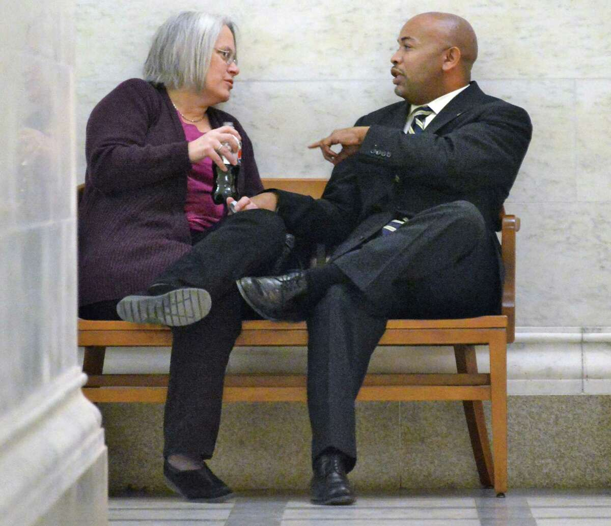 Assembly members Helene Weinstein, left, and Carl Heastie speak in a hallway outside the Assembly Chambers Tuesday Jan. 27, 2015. (John Carl D'Annibale / Times Union)