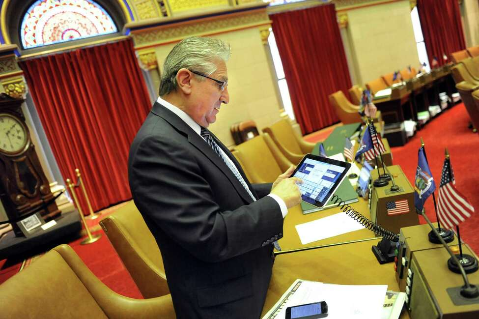 Assemblyman Jim Tedisco gets familiar with the new tablets in the Chamber on Wednesday, April 22, 2015, at the Capitol in Albany, N.Y. The Assembly will use the tablets for the first time on Earth Day in place of paper bills. (Cindy Schultz / Times Union)