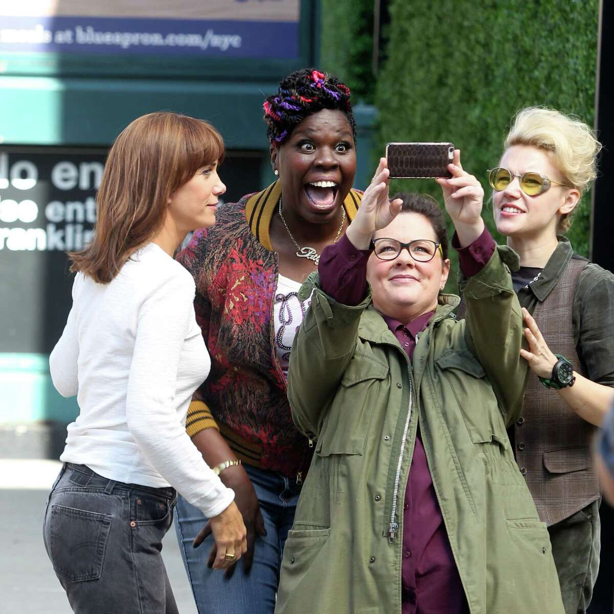 """Melissa McCarthy takes a selfie with, from left, Kristen Wiig, Leslie Jones and Kate McKinnon in a break in the action on the set of the new """"Ghostbusters."""""""