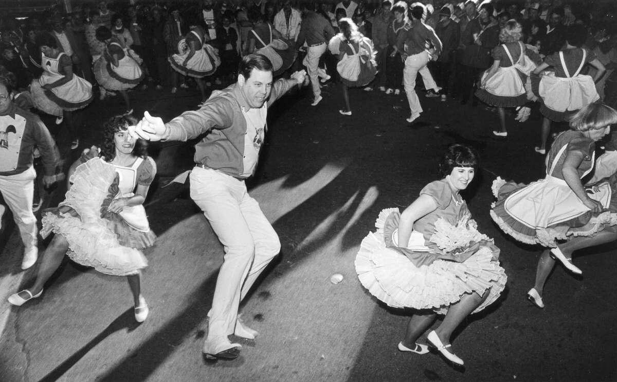 1989 - Cadence Cloggers kick up their heels at the New Year's bash at Alamo Plaza.