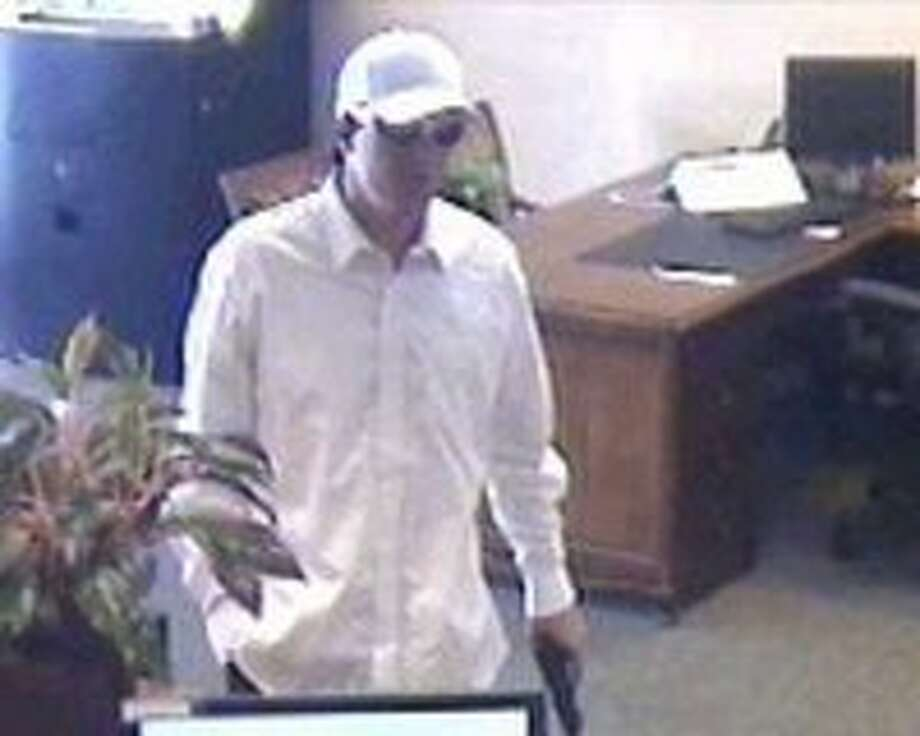 Suspect in the July 13 robbery at a Liberty Bank at 6230 Highway 9 in Felton (Santa Cruz County). The bandit threatened bank employees and customers, locking them in the vault before fleeing with an undetermined amount of cash.