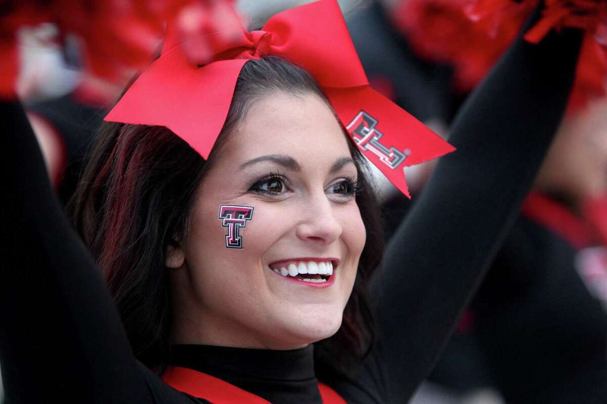 Texas Tech cheerleaders prepare to welcome players in the Spirit walk before a game against LSU in the Advocare V100 Texas Bowl at NRG Stadium Tuesday, Dec. 29, 2015, in Houston.
