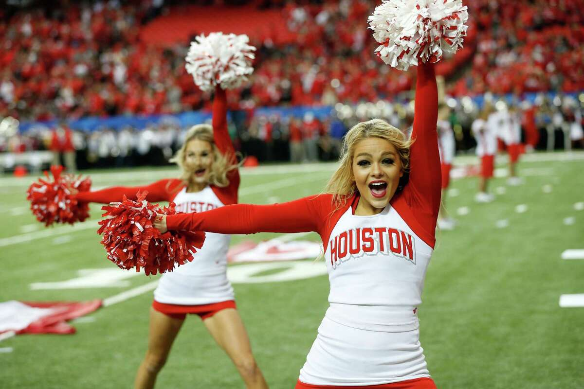 Houston cheerleaders perform before the first half of the Peach Bowl NCAA college football game between Florida State and Houston, Thursday, Dec. 31, 2015, in Atlanta. (AP Photo/John Bazemore)
