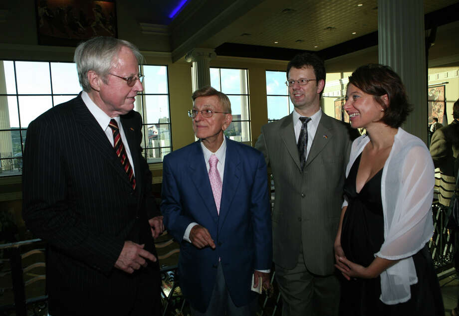 John L. Santikos (second from left) is shown at the European Film Festival reception at the Palladium Theater in 2008. Santikos, who died in December 2014, left $605 million in assets to the San Antonio Area Foundation. Photo: Express-News File Photo / SAN ANTONIO EXPRESS-NEWS