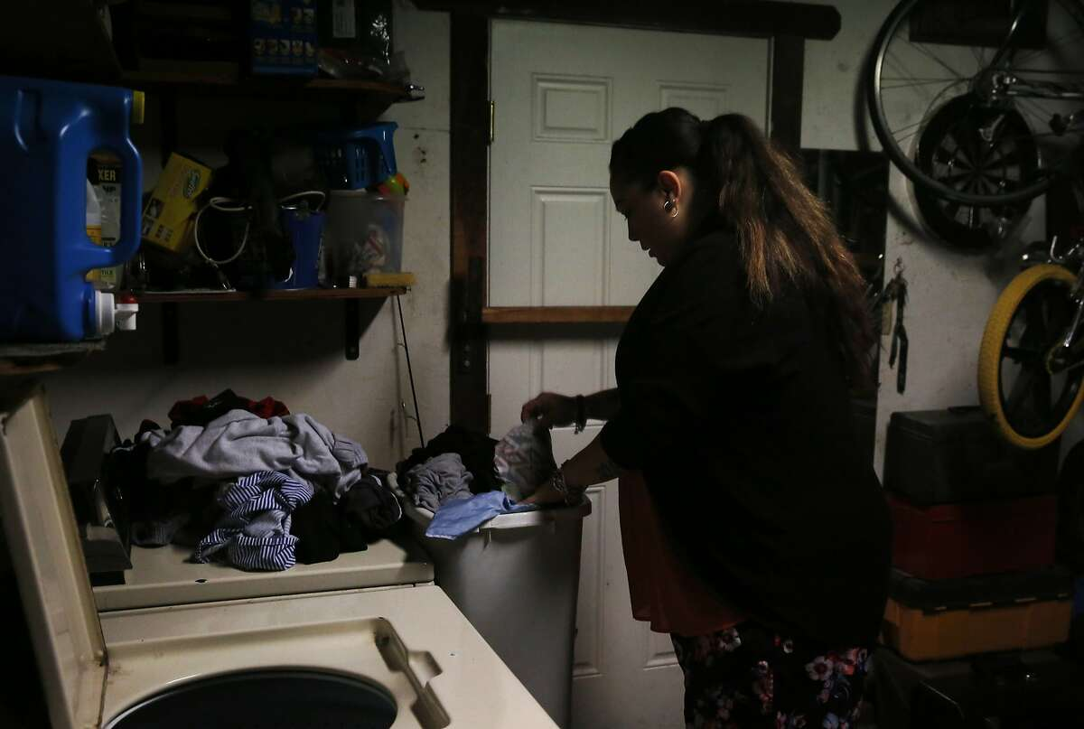 A woman does laundry at home in Pittsburg, California.