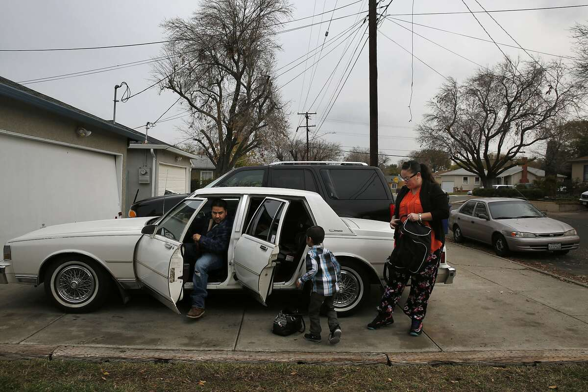 From left, Victor Martinez, 32, Kazsh Martinez, 6, and Sonya Tafoya, 40, get into the car to run errands outside of their family home Dec. 30, 2015 in Pittsburg, Calif. Tafoya is born and raised in Pittsburg. She has a criminal history and she says it was her last stint in jail that helped straighten her out. Tafoya hasn't been in trouble since the early 2000s.
