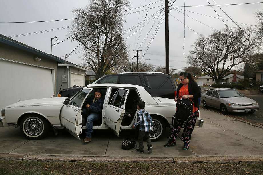 Victor Martinez, 6-year-old Kazsh Martinez and Sonya Tafoya get ready to run errands outside their family home in Pittsburg. Tafoya is getting job skills and life skills coaching, and hopes to change her career path. Photo: Leah Millis, The Chronicle