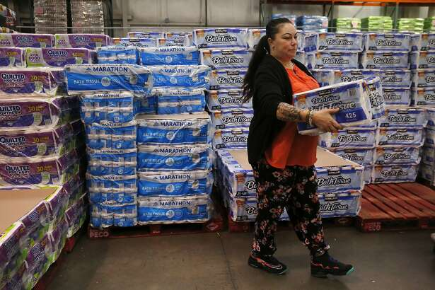 Sonya Tafoya, 40, carries toilet paper to her cart inside Costco after Tafoya's grandmother gave her $50 and she decided to spend it at the store getting supplies for the family Dec. 30, 2015 in Pittsburg, Calif. Tafoya is born and raised in Pittsburg. She has a criminal history and she says it was her last stint in jail that helped straighten her out. Tafoya hasn't been in trouble since the early 2000s.
