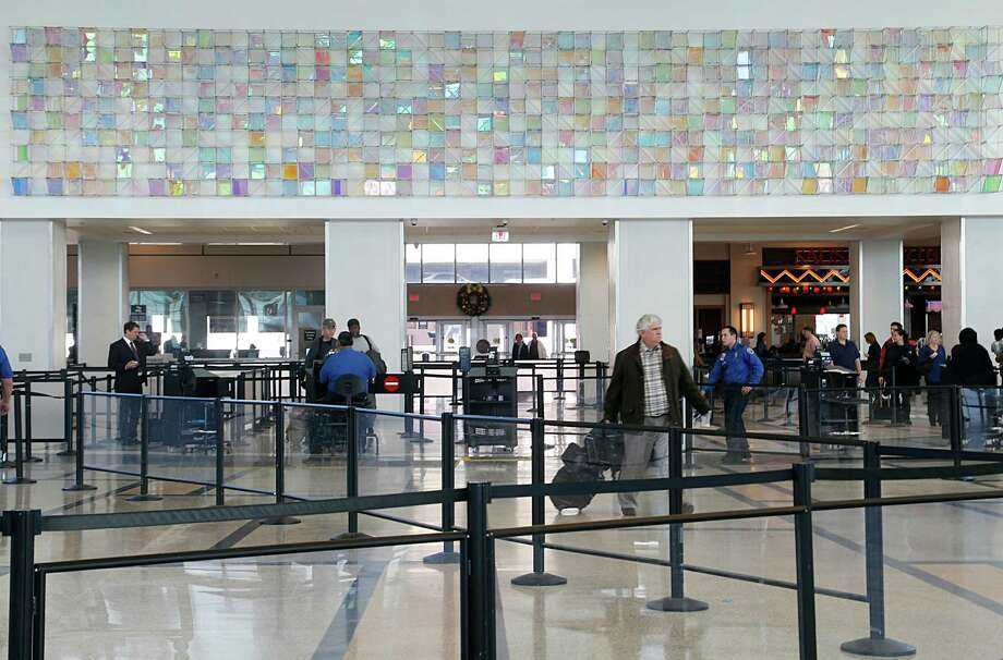 """Christian Eckart's """"Cloud Room Field"""" spans 60 feet above the central security checkpoint at the airport's main entrance. Photo: James Nielsen, Staff / © 2015  Houston Chronicle"""