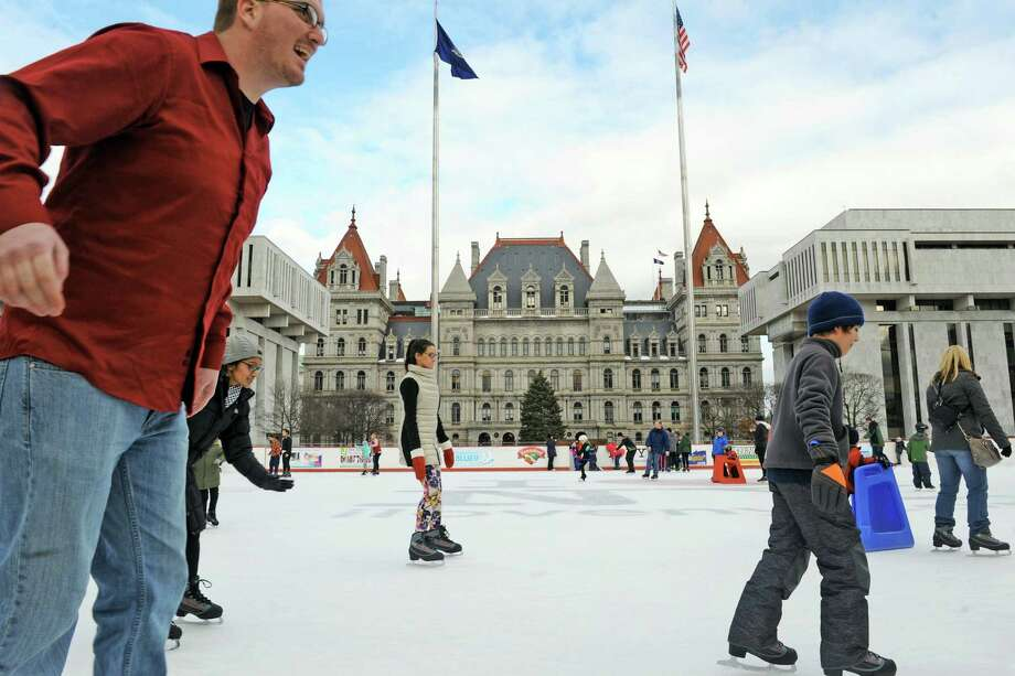 Skaters take to the ice at the Empire State Plaza rink on Thursday Dec. 31, 2015 in Albany, N.Y.  (Michael P. Farrell/Times Union) Photo: Michael P. Farrell / 10034843A