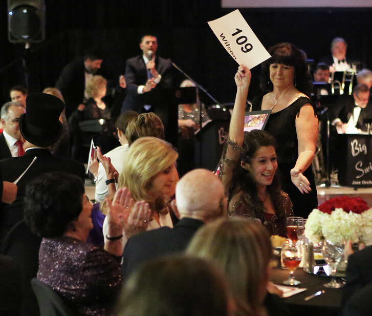 Foundation donor Stephanie Wilson celebrates her winning bid during a live auction at the 16th annual Alvin Community College Foundation Gala Nov. 20.Foundation donor Stephanie Wilson celebrates her winning bid during a live auction at the 16th annual Alvin Community College Foundation Gala Nov. 20.