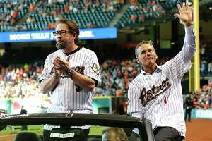 2005 National League Championship team members Jeff Bagwell left, and Craig Biggio are driven onto the field during Astros Legends Weekend at Minute Maid Park Saturday, Aug. 15, 2015, in Houston.   ( James Nielsen / Houston Chronicle )