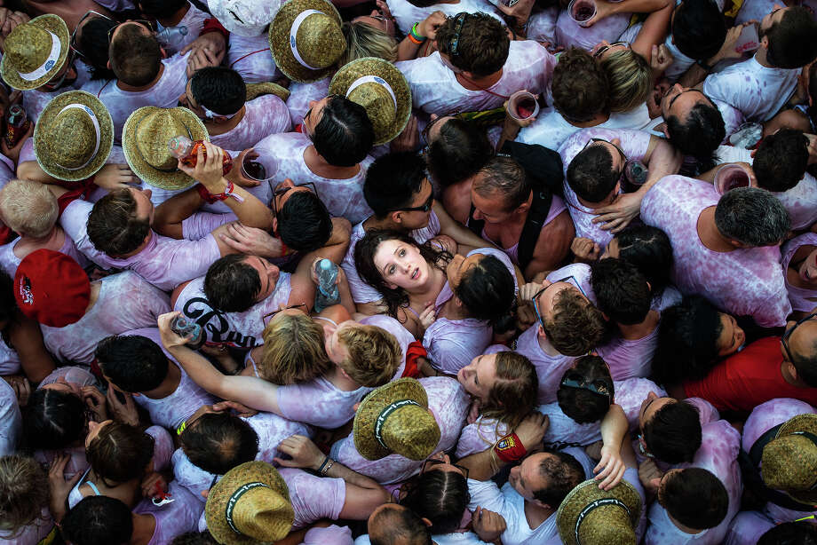 "The photojournalists of Getty Images bring us the ""Year in Focus,"" a unique look back at 2015.Above:Revelers enjoy the atmosphere during the opening day or 'Chupinazo' of the San Fermin Running of the Bulls fiesta on July 6, 2015 in Pamplona, Spain. Photo: David Ramos, Getty Images / 2015 Getty Images"