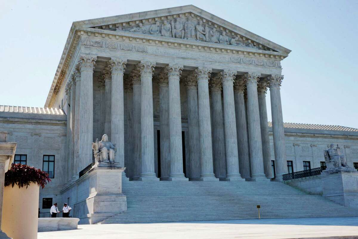 FILE PHOTO - The U.S. Supreme Court will hear arguments next week about a 2013 law requiring all abortions in Texas take place in ambulatory surgical centers. (AP Photo/Jacquelyn Martin, File)
