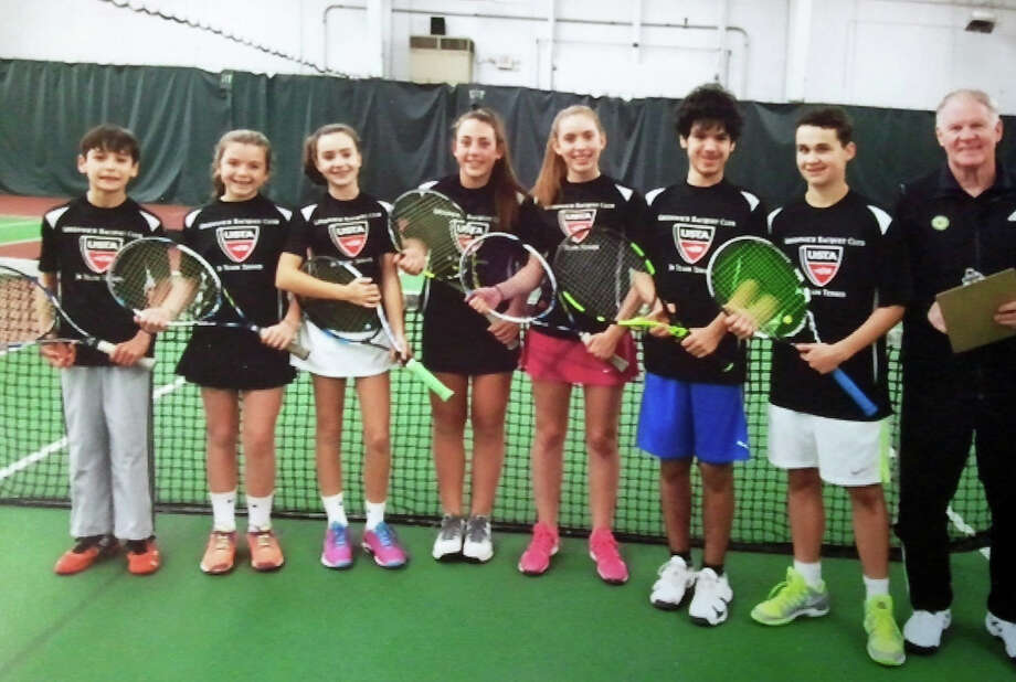 The Greenwich Racquet Club 14-and-under team won the Southern Connecticut Fall Junior Divisional championship. The championship team included, from left to right, Alden Tucker, Kendall Schrohe, Molly Cadman, Christina Gianesello, Jane Cameron, Pietro DeFerrari and Hayden Winter. To the far right is Greenwich Racquet Club tennis professional Andy Reid. Photo: Contributed Photo /Contributed Photo