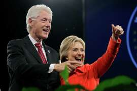 Former President Bill Clinton and his wife, Democratic presidential candidate Hillary Rodham Clinton, wave to supporters after the Iowa Democratic Party's Jefferson-Jackson fundraising dinner. The former president will hit the campaign trail for his wife this month.