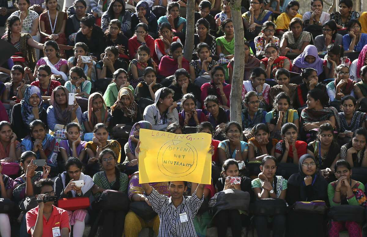 """Indian students gather for a protest against Facebook's """"Free Basics"""" in Hyderabad, India, Tuesday, Dec.29, 2015.Promoted by Facebook founder, Mark Zuckerberg, Free Basics offers free Internet access to a few websites to people who do not have any access to the Internet. However, critics of """"Free Basics"""" say, Facebook's plan goes against the principle that the Internet should be available to all and not be limited or determined by a single company. (AP Photo/Mahesh Kumar A.)"""