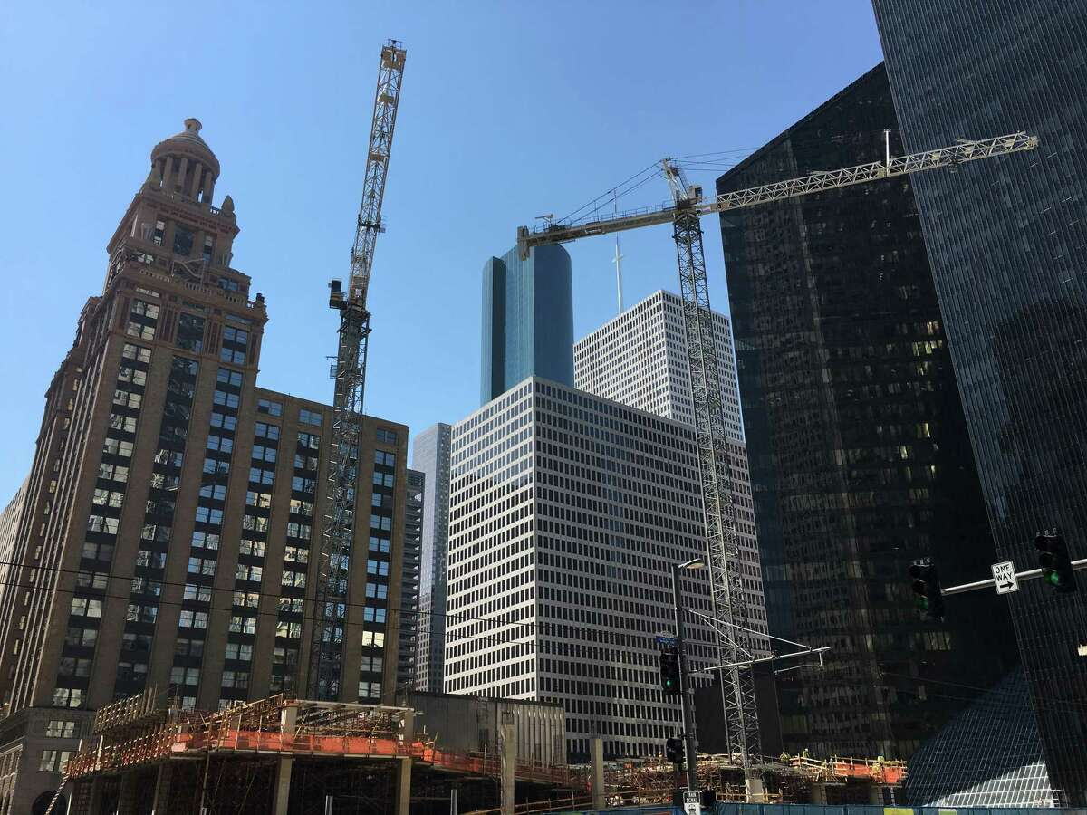 Construction cranes in downtown Houston in the fall of 2015.