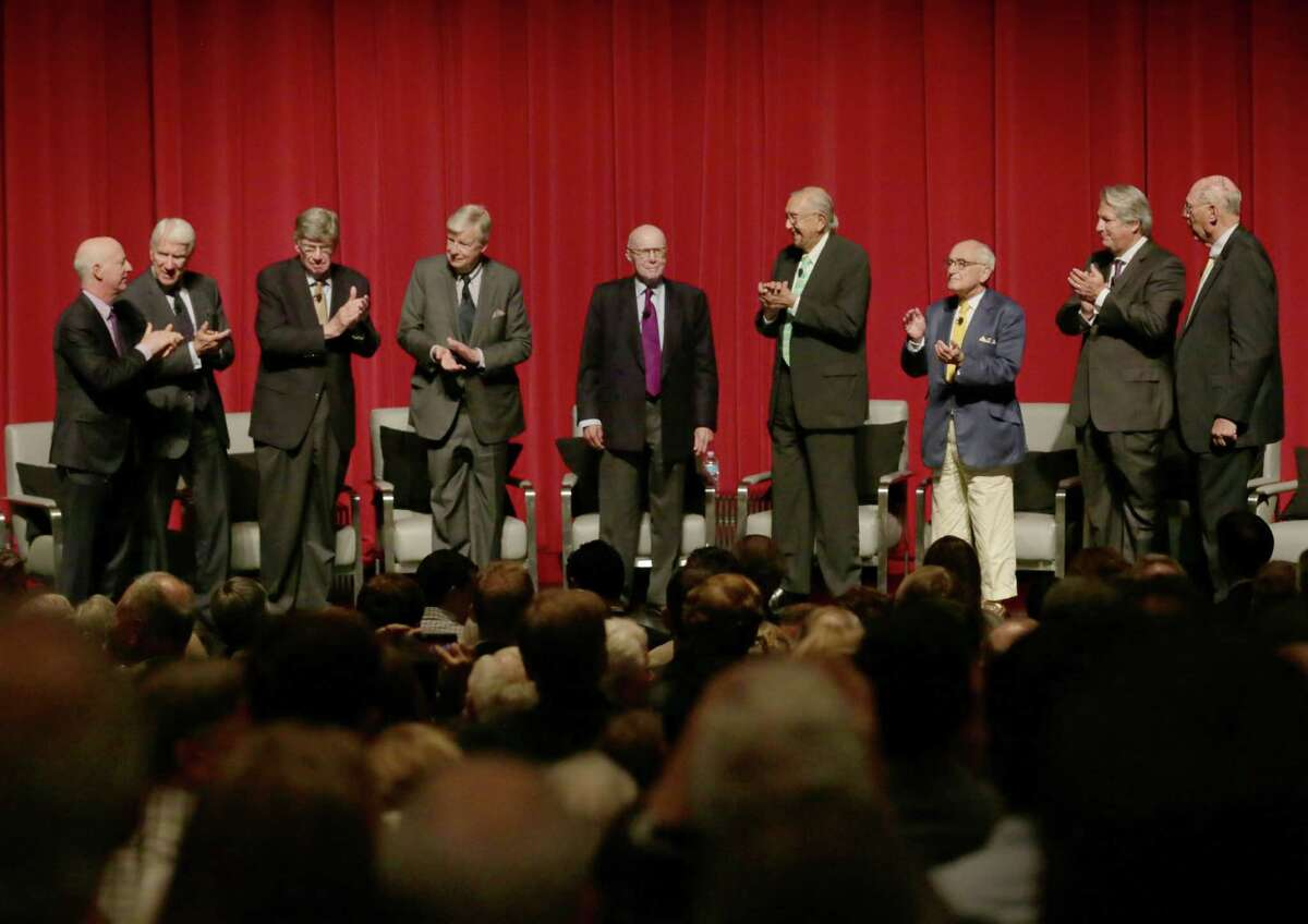 Gerald Hines, center, enjoys the moment as fellow panelists, from left, Paul Goldberger, Eugene Kohn, John Burgee, Henry Cobb, Cesar Pelli, Robert A.M. Stern, Jon Pickard and Arthur Gensler Jr. honor him.