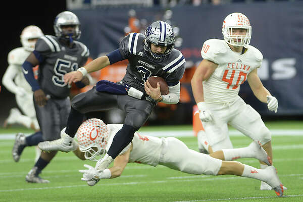 West Orange-Stark's Jack Dallas is tripped up by Celina's Travis Tolbert as he runs the ball during Friday's state finals championship game at NRG Stadium in Houston.   Photo taken Friday, December 18, 2015 Kim Brent/The Enterprise