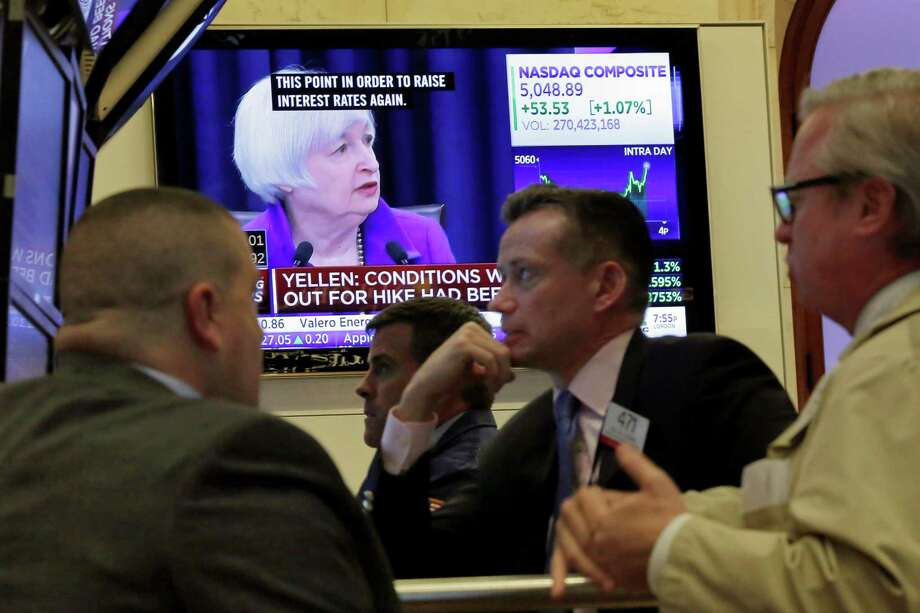 Federal Reserve Chair Janet Yellen's news conference is shown on a TV screen on the floor of the New York Stock Exchange. Wall Street watched few things more closely this year than the Federal Reserve. Photo: Richard Drew /Associated Press / AP