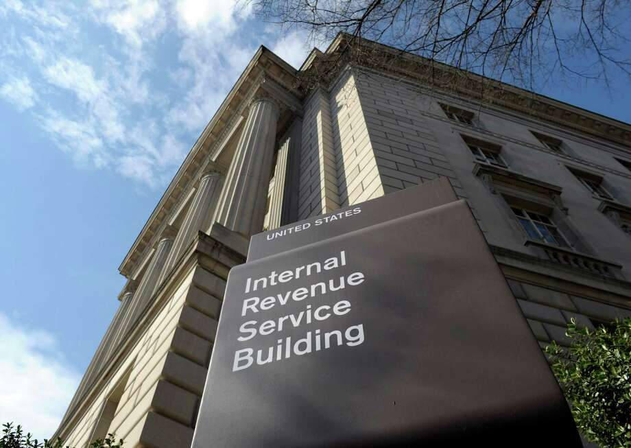 This photo taken March 22, 2013, shows the exterior of the Internal Revenue Service (IRS) building in Washington. The IRS issued $4 billion in fraudulent tax refunds last year to people using stolen identities, with some of the money going to addresses in Bulgaria, Lithuania and Ireland, according to a Treasury report released Thursday. The IRS sent a total of 655 tax refunds to a single address in Lithuania, and 343 refunds went to a lone address in Shanghai. (AP Photo/Susan Walsh) Photo: Susan Walsh, STF / AP