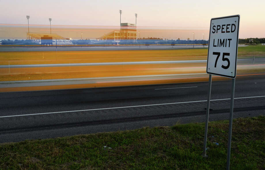 After a brief study with a radar gun, the Texas Department of Transportation will soon be lowering the Interstate 10 speed limit from Beaumont to Winnie to 65 miles per hour. A yellow moving truck drives past a speed limit sign near the outskirts of Beaumont on Monday.