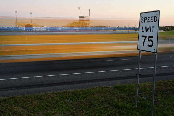 After a brief study with a radar gun, the Texas Department of Transportation will soon be lowering the Interstate 10 speed limit from Beaumont to Winnie to 65 miles per hour. A yellow moving truck drives past a speed limit sign near the outskirts of Beaumont on Monday. Photo taken Monday, November 09, 2015 Guiseppe Barranco/The Enterprise