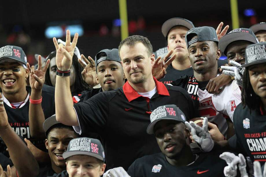 Houston Cougars head coach Tom Herman poses for a photos with his team after the Chick-fil-A Peach Bowl at the Georgia Dome on Thursday, Dec. 31, 2015, in Atlanta. Houston beat Florida State University 38-24. Photo: Elizabeth Conley, Houston Chronicle / © 2015 Houston Chronicle