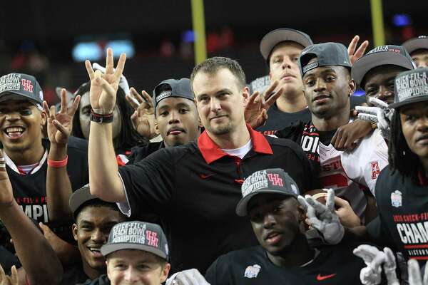 Houston Cougars head coach Tom Herman poses for a photos with his team after the Chick-fil-A Peach Bowl at the Georgia Dome on Thursday, Dec. 31, 2015, in Atlanta. Houston beat Florida State University 38-24.