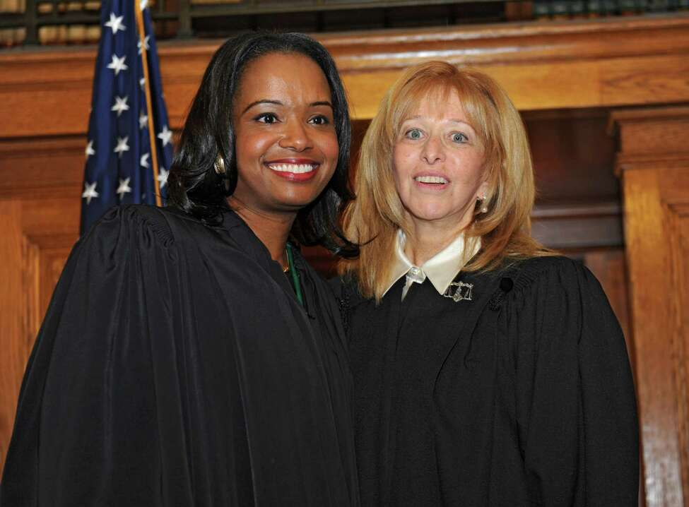 Hon. Christina Ryba, left, and Hon. Rachel Kretser pose for a photo after Ryba was sworn in as state Supreme Court Justice at the Albany County Courthouse on Thursday, Dec. 31, 2015 in Albany, N.Y. She becomes the first African-American woman elected to the Supreme Court bench in the 3rd Judicial District. (Lori Van Buren / Times Union)